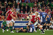 Ian Evans (Lions) offloads to Rory Best (Lions) during the tour match of the 2013 British And Irish Lions Australian Tour between RaboDirect Melbourne Rebels vs British And Irish Lions at AAMI Park, Melbourne, Victoria, Australia. 25/06/0213. Photo By Lucas Wroe