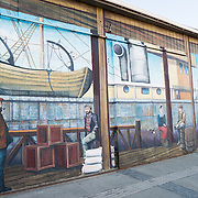 Large painted murals paying tribute to the city's maritime history on buildings on the waterfront of Punta Arenas, Chile. The city is the largest south of the 46th parallel south and capital city of Chile's southernmost region of Magallanes and Antartica Chilena.