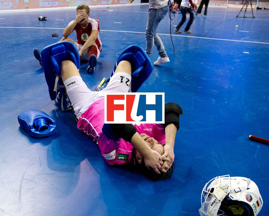 BERLIN - Indoor Hockey World Cup<br /> Final: Germany - Austria<br /> Austria wins the world championship.<br /> foto: Tobias Walter defeated while Michael K&ouml;rper celebrates.<br /> WORLDSPORTPICS COPYRIGHT FRANK UIJLENBROEK