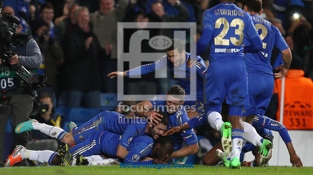 Picture by Paul Terry/Focus Images Ltd +44 7545 642257.07/11/2012.Victor Moses (C ) of Chelsea celebrates with team mates after scoring the winning goal to make it 3-2 during the UEFA Champions League match at Stamford Bridge, London.