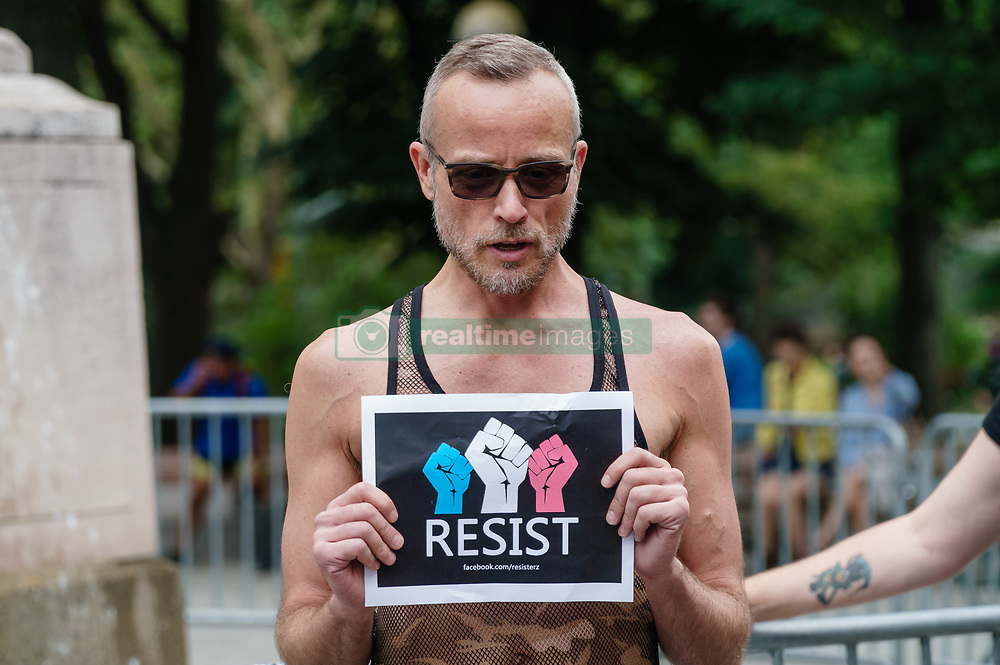 July 29, 2017 - New York, NY, United States - Participants hold signs will protesting the ban against transsexual military personnel.  At back-to-back rallies in midtown Manhattan, liberal activists rallied against President Trumps intentions to disallow transsexual officers to serve in the U.S. armed forces and then rallied to denounce efforts by the President and Republican politicians to repeal and replace the Affordable Care Act  (Credit Image: © Albin Lohr-Jones/Pacific Press via ZUMA Wire)