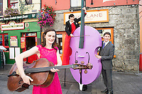 08/09/2014 Repro Free , Sarah Joyce, cellist   with and Beau Holland, stiltwalker with Finghin Collins, Artistic Director (Music for Galway) at the launch of Music for Galway's 34th International Concert Season.  <br /> Picture:Andrew Downes