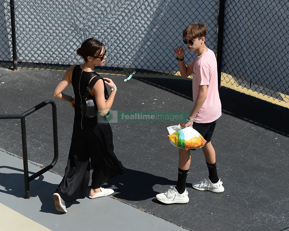 KEY BISCAYNE, FL - APRIL 01 : Victoria Beckham and David Beckham seen watching John Isner Vs Alexander Zverev during the mens final during the 2018 Miami Open at Crandon Park Tennis Center on April 1, 2018 in Key Biscayne, Florida. CAP/MPI04 ©MPI04/Capital Pictures. 01 Apr 2018 Pictured: Victoria Beckham, Romeo Beckham. Photo credit: MPI04/Capital Pictures / MEGA TheMegaAgency.com +1 888 505 6342