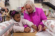 """20181203, Monday, December 3, 2018, North Easton, MA, USA; The Christmas program at My Brother's Keeper in Easton is planning to serve over 3,000 families with over 12,000 parents and children for 2018.<br />  <br /> The regional Christian Ministry, based in North Easton Massachusetts, began the first full day of the annual volunteer-fueled Christmas program when there will be a warehouse facility full of wrapping volunteers and gifts waiting to be selected and wrapped.<br /> <br /> The charity gift giving and wrapping program, in it's 28th year, is ongoing in """"Santa's Workshop"""" during the Advent season 11 a.m. to 8 p.m. each day.<br /> <br /> ( 2018 © lightchaser photography )"""