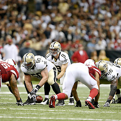 Sep 22, 2013; New Orleans, LA, USA; New Orleans Saints quarterback Drew Brees (9) at the line against the Arizona Cardinals during the second half of a game at Mercedes-Benz Superdome. The Saints defeated the Cardinals 31-7. Mandatory Credit: Derick E. Hingle-USA TODAY Sports