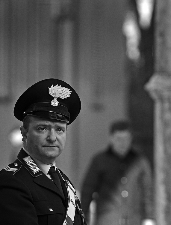 Black and white photograph of Italian cop in Bologna.