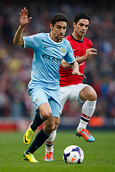 Man City Midfielder Jesus Navas (ESP) is challenged by Arsenal Midfielder Mikel Arteta (ESP) - Photo mandatory by-line: Rogan Thomson/JMP - 07966 386802 - 29/03/14 - SPORT - FOOTBALL - Emirates Stadium, London - Arsenal v Manchester City - Barclays Premier League.