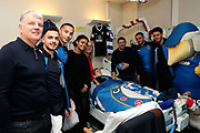 AFC Wimbledon first team coach Glyn Hodges, AFC Wimbledon attacker Egli Kaja (21), AFC Wimbledon defender Rod McDonald (26), AFC Wimbledon midfielder Anthony Hartigan (8), AFC Wimbledon defender Will Nightingale (5), Haydon the Womble delivering Christmas presents to the children on behalf of AFC Wimbledon, at St George's Hospital, Tooting, United Kingdom on 13 December 2018.