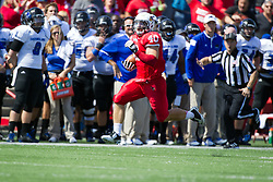 13 September 2014:  Alex Donnelly intercepts a pass and heads up the field near the sidelines during an NCAA football game between the Eastern Illinois Panthers and the Illinois State Redbirds at Hancock Stadium in Normal IL