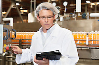 Middle-aged man working in a bottling factory
