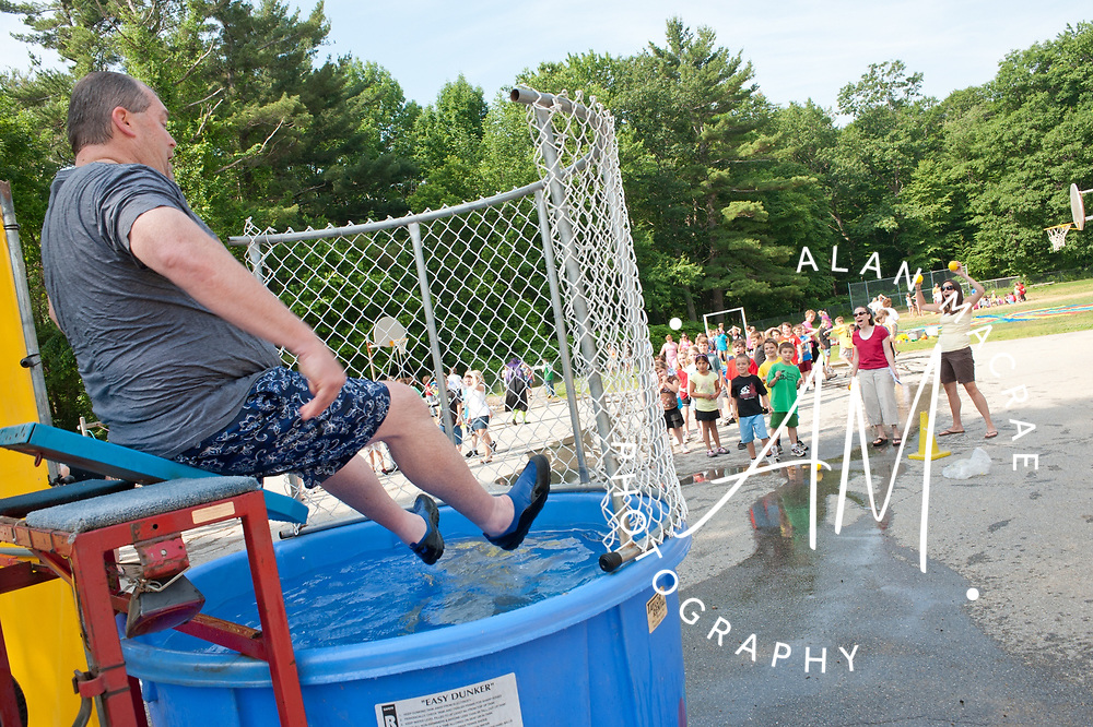 Elm Street School principal Eric Johnson slides into the dunk tank, to the delight of his students, as part of Friday's Harry Potter festivities at the school(Alan MacRae/for the Citizen)