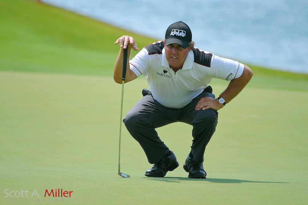 Phil Mickelson lines up a putt on the 18th hole during the first round of the Players Championship at TPC Sawgrass on May 8, 2008 in Ponte Vedra Beach, Florida.     © 2008 Scott A. Miller