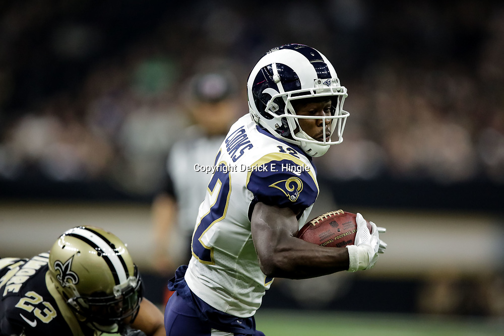Nov 4, 2018; New Orleans, LA, USA; Los Angeles Rams wide receiver Brandin Cooks (12) breaks away from New Orleans Saints cornerback Marshon Lattimore (23) during the first half at the Mercedes-Benz Superdome. Mandatory Credit: Derick E. Hingle-USA TODAY Sports