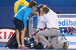 © Licensed to London News Pictures. 26/01/2013. Melbourne Park, Australia. Li Na gets medical attention after falling over during the Womens Final between Victoria Azarenka and Li Na of the Australian Open. Photo credit : Asanka Brendon Ratnayake/LNP