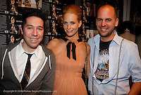"Brian Wolk, Poppy Delavigne and Claude Morais attend the opening of ""Lady"" by Douglas Friedman at the Ruffian Gallery on April 23, 2009 in New York City."