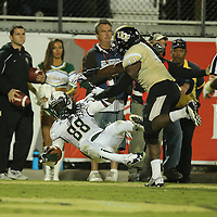 South Florida Bulls wide receiver Chris Dunkley (88) scores a touchdown during an NCAA football game between the South Florida Bulls and the 17th ranked University of Central Florida Knights at Bright House Networks Stadium on Friday, November 29, 2013 in Orlando, Florida. (AP Photo/Alex Menendez)