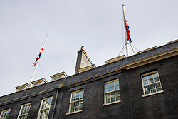 © Licensed to London News Pictures. 04/06/2017. London, UK. Union flags are seen half mast in Downing Street, London following a terror attack that killed 6 people on London Bridge and Borough in central London. Photo credit: Tolga Akmen/LNP