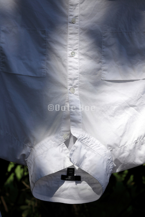 white shirt hanging to dry