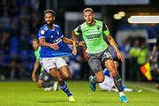 AFC Wimbledon defender Nesta Guiness-Walker (18) tussles with Ipswich Town defender Janoi Donacien (2) during the EFL Sky Bet League 1 match between Ipswich Town and AFC Wimbledon at Portman Road, Ipswich, England on 20 August 2019.