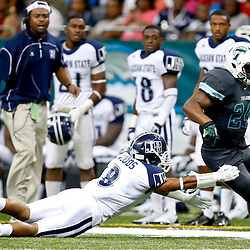 Aug 29, 2013; New Orleans, LA, USA; Tulane Green Wave running back Dante Butler (24) breaks away from Jackson State Tigers safety Travis Wood (8) during the first half of a game at the Mercedes-Benz Superdome. Mandatory Credit: Derick E. Hingle-USA TODAY Sports
