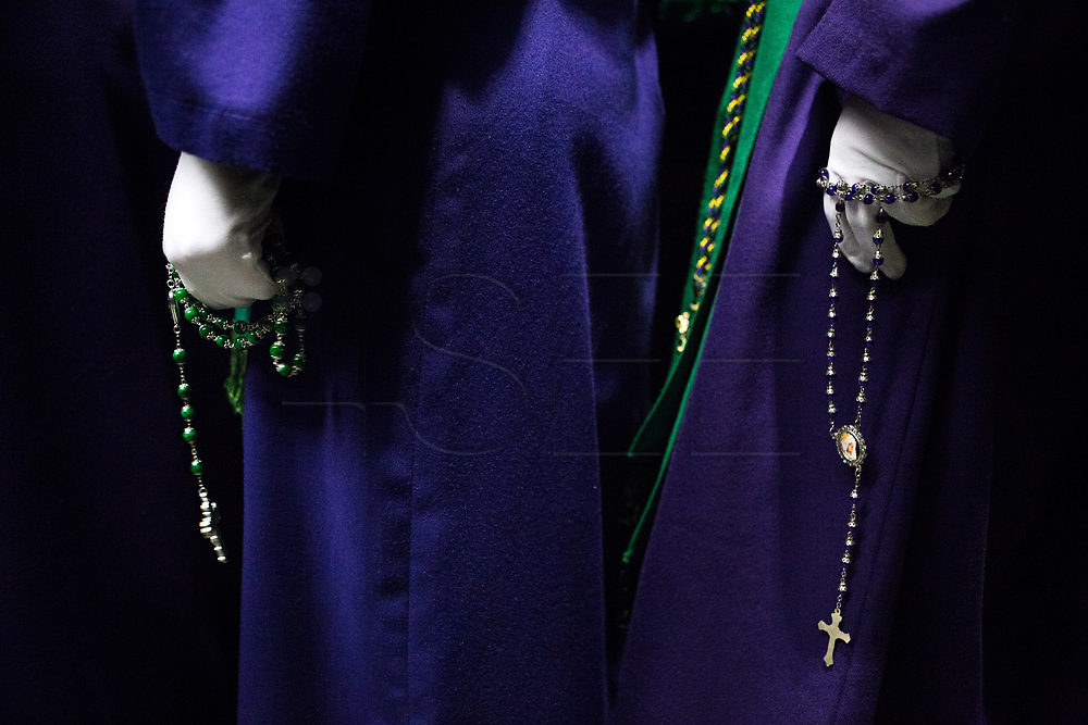 Penintents of &quot;Nuestra Se&ntilde;ora de la Esperanza&quot; brotherhood praying. General Procession of Good Friday considered<br /> Cultural Heritage of Matar&oacute; city (Barcelona, Spain) since 2013.  Easter 2015. Eva Parey/4SEE