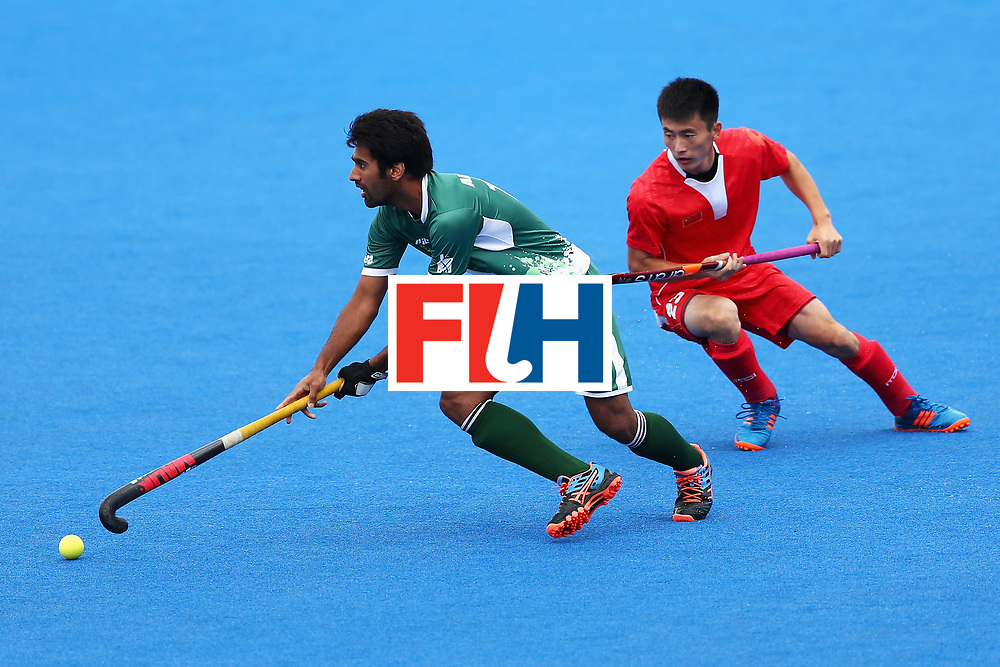 LONDON, ENGLAND - JUNE 25:  Ali Shan of Pakistan takes the ball away from Zixiang Gou of China during the 7th/8th place match between Pakistan and China on day nine of the Hero Hockey World League Semi-Final at Lee Valley Hockey and Tennis Centre on June 25, 2017 in London, England.  (Photo by Steve Bardens/Getty Images)