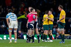 A linesman congratulates referee Wayne Barnes after Australia win the match 15-29 - Mandatory byline: Rogan Thomson/JMP - 07966 386802 - 25/10/2015 - RUGBY UNION - Twickenham Stadium - London, England - Argentina v Australia - Rugby World Cup 2015 Semi Finals.