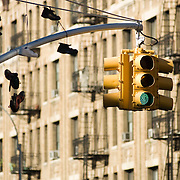 Shoes hang from power lines and a stop light pole in Inwood, northern Manhattan.  New York City, NY.