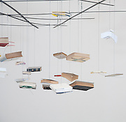 Richard Wentworth: Untitled. 2009 Installation, books, iron and steel cable (hanging books)..53rd Venice Biennale, 7 June - 22 November 2009..Giardini - Fare Mondi // Making Worlds. Central international exhibition, curated by Daniel Birnbaum.