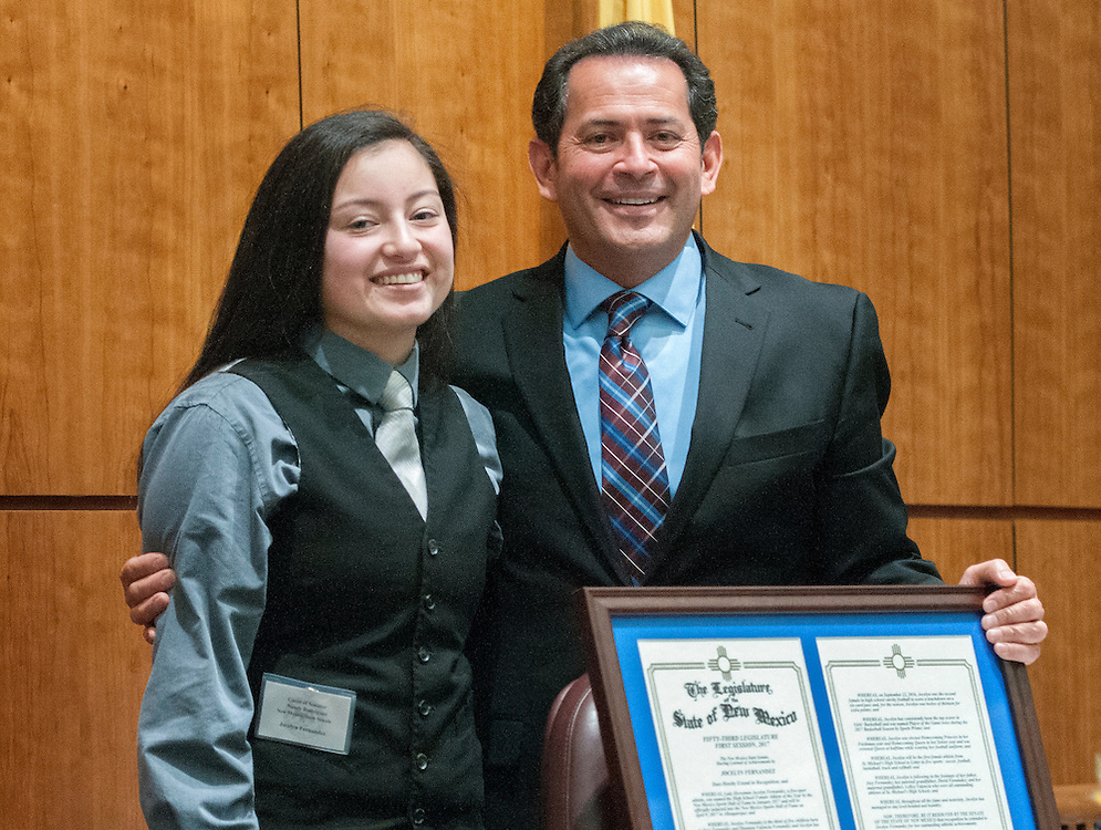 em021517c/jnorth/Jocelyn Fernandez, from St. Michael's High School, poses with Lt. Gov. John Sanchez after receiving a Certificate of Recognition in the Senate at the State Capitol, Wednesday February 15, 2017. The certificate was for Fernandez's accomplishments in 5 sports, including track, basketball and becoming only the second female in state history to score a touchdown in varsity football game. Fernandez is daughter of St. Michael's football coach Joey Fernandez. (Eddie Moore/Albuquerque Journal