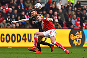 Stuart Dallas (15) of Leeds United battles for possession with Adam Webster (4) of Bristol City during the EFL Sky Bet Championship match between Bristol City and Leeds United at Ashton Gate, Bristol, England on 9 March 2019.