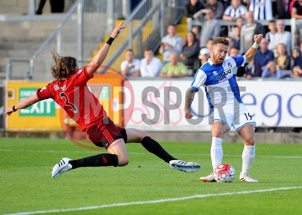 Matty Taylor of Bristol Rovers is challenged by Jonas Olsson of West Brom - Mandatory by-line: Neil Brookman/JMP - 07966386802 - 31/07/2015 - SPORT - FOOTBALL - Bristol,England - Memorial Stadium - Bristol Rovers v West Brom - Pre-Season Friendly