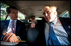 London Mayor Boris Johnson in the car travelling back to the centre of  Delhi with Charlie Mayfield Chairman of The John Lewis Partnership, on the Second day of a six-day tour of India, where he will be trying to persuade Indian businesses to invest in London, Monday November 26, 2012. Photo by Andrew Parsons / i-Images