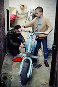 Neville and Symond with a scooter, High Wycombe, UK, 1980s.