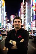 Tokyo, Japon, 30 janvier 2010 - Salon du chocolat au grand magasin de luxe Isetan, Shinjuku, 2 semaines avant la St Valentin. Sebastien Bouillet, un des quatre patissiers francais ayant une boutique chez Isetan, pose devant ls neons du quartier de Shinjuku.