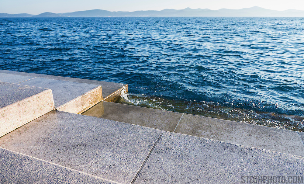 The steps of the Sea Organ in Zadar, Croatia where land meets the water (Adriatic Sea). Designed by architect Nikola Basic, 35 organ pipes are built under the steps so that the wind and water from the sea create musical sounds.<br />