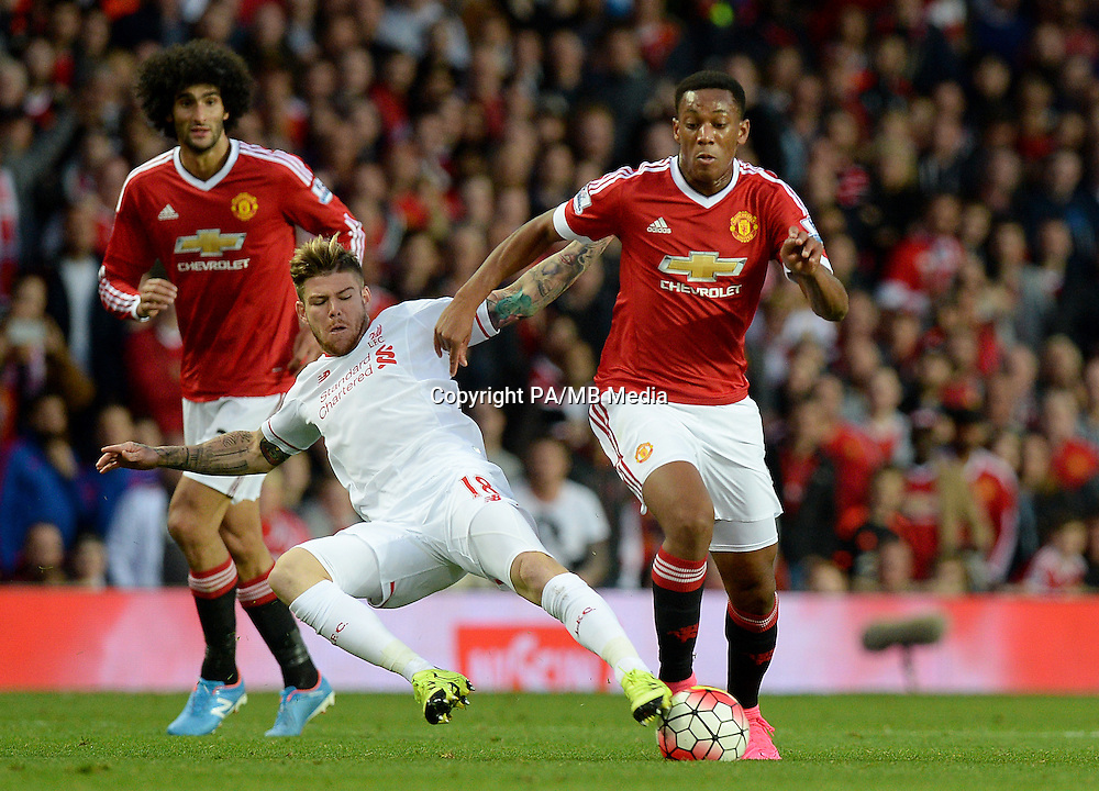 Liverpool's Alberto Moreno (left) challenges Manchester United's Anthony Martial during the Barclays Premier League match at Old Trafford, Manchester.