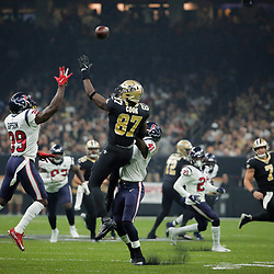 Sep 9, 2019; New Orleans, LA, USA; Houston Texans free safety Tashaun Gipson (39) and New Orleans Saints tight end Jared Cook (87) go up for a pass during the first quarter at the Mercedes-Benz Superdome. Mandatory Credit: Derick E. Hingle-USA TODAY Sports
