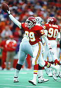 Kansas City Chiefs defensive back Eric Everett (39) holds the ball in the air as he celebrates an interception during the NFL AFC Wild Card playoff football game against the Los Angeles Raiders on Dec. 28, 1991 in Kansas City, Mo. The Chiefs won the game 10-6. (©Paul Anthony Spinelli)