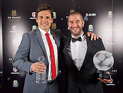 CARDIFF, WALES - Tuesday, November 8, 2016: FAW Special Award winner manager Chris Coleman and Dafabet Welsh Premier League Clubman of the Year Award winner The New Saints' Phil Baker with their trophies during the FAW Awards Dinner at the Vale Resort. (Pic by David Rawcliffe/Propaganda)