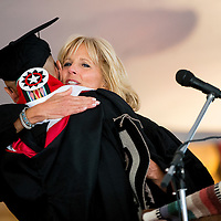 051713       Brian Leddy<br /> Jill Biden, wife of Vice President Joe Biden, hugs Sherwin Becenti after his speach at Navajo Technical College Friday in Crownpoint. Biden was the featured speaker at the event this year.
