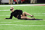 American singer, songwriter, actress and record producer Lady Gaga poses for a photograph while laying on the field turf wearing sunglasses before the Atlanta Falcons Super Bowl LI football game against the New England Patriots on Sunday, Feb. 5, 2017 in Houston. The Patriots won the game 34-28 in overtime. (©Paul Anthony Spinelli)