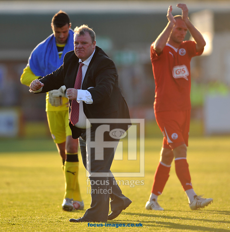 Picture by Daniel Hambury/Focus Images Ltd. 07813 022858.22/10/11.Steve Evans, manager of Crawley celebrates with fans following his sides 5-2 win against AFC Wimbledon in the Npower League 2 match at The Cherry Red Records Fans' stadium, Kingston Upon Thames, Surrey.
