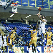Delaware Forward Carl Baptiste (33) shoot a 15 footer in the first half of a NCAA regular season Colonial Athletic Association conference game between Delaware and Hofstra Wednesday, JAN 8, 2014 at The Bob Carpenter Sports Convocation Center in Newark Delaware.