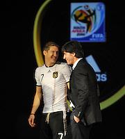 Fussball Nationalmannschaft :  Saison   2009/2010   10.11.2009 ADIDAS WM 2010 Trikot Vorstellung (Teamgeist) Bastian Schweinsteiger mit Joachim Loew  (GER)