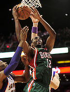 Feb. 2, 2011; Phoenix, AZ, USA; Milwaukee Bucks forward Luc Mbah a Moute (12) puts up a shot against the Phoenix Suns at the US Airways Center. Mandatory Credit: Jennifer Stewart-US PRESSWIRE