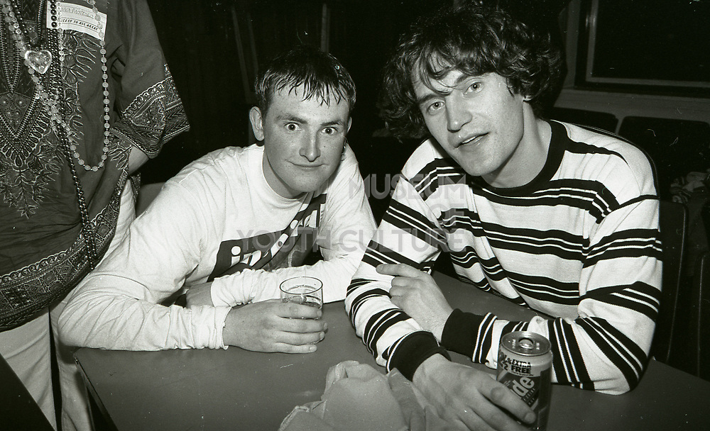 Stephen Holt and Graham Lambert drinking together after Inspiral Carpets gig, Manchester, UK, circa 1990