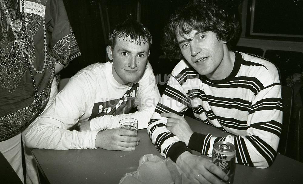 Stephen Holt and Graham Lambert drinking together after Inspiral Carpets gig, Manchester, UK, circa 1990