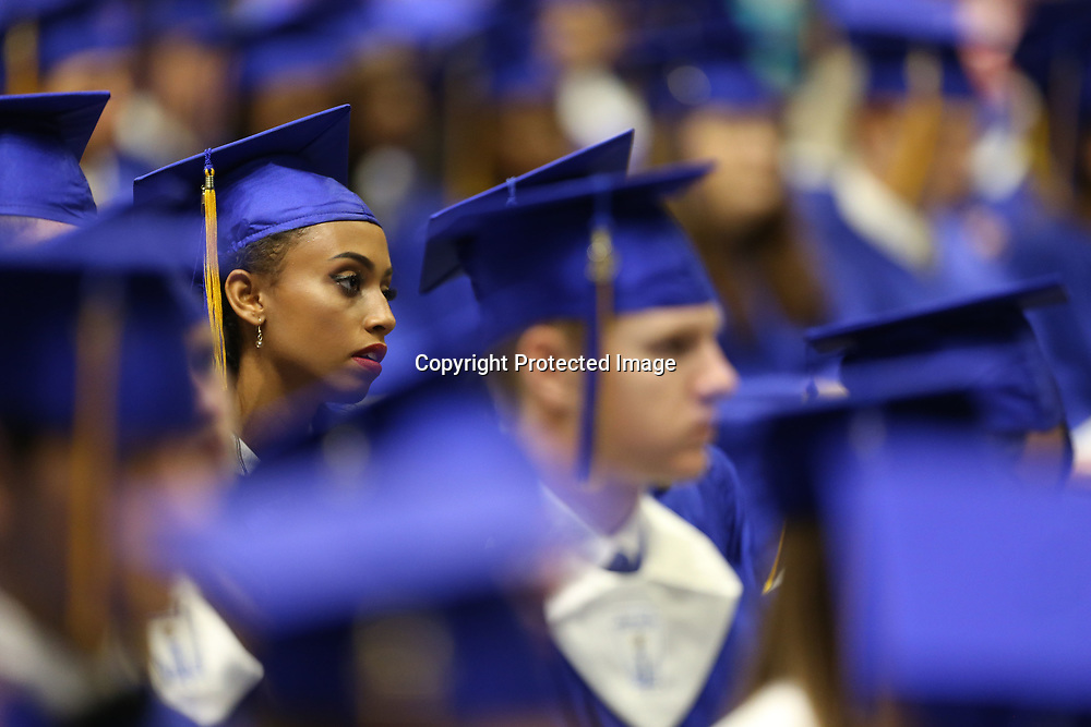 A Tupelo High School graduating senior listens as Mary Edith Thomas speaks during the Tupelo High School Graduation Ceremony Friday night at the BancorpSouth Arena.
