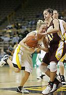 25 JANUARY 2007:  Iowa guard Kristi Smith (11) tries to drive past Minnesota guard Brittany McCoy (12) in Iowa's 80-78 overtime loss to Minnesota at Carver-Hawkeye Arena in Iowa City, Iowa on January 25, 2007.